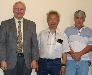 Gerald F. Dudding with inventors Jim Chang and Ken Monroe